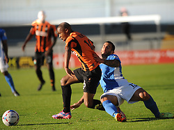 Eastleighs Stuart Fleetwood brings down Barnets Mauro Vilhete, Barnet v Eastleigh, Vanarama Conference, Saturday 4th October 2014