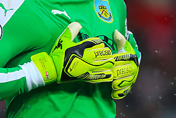 Detail of the gloves of Burnley goalkeeper Thomas Heaton during the Premier League match at Anfield, Liverpool.