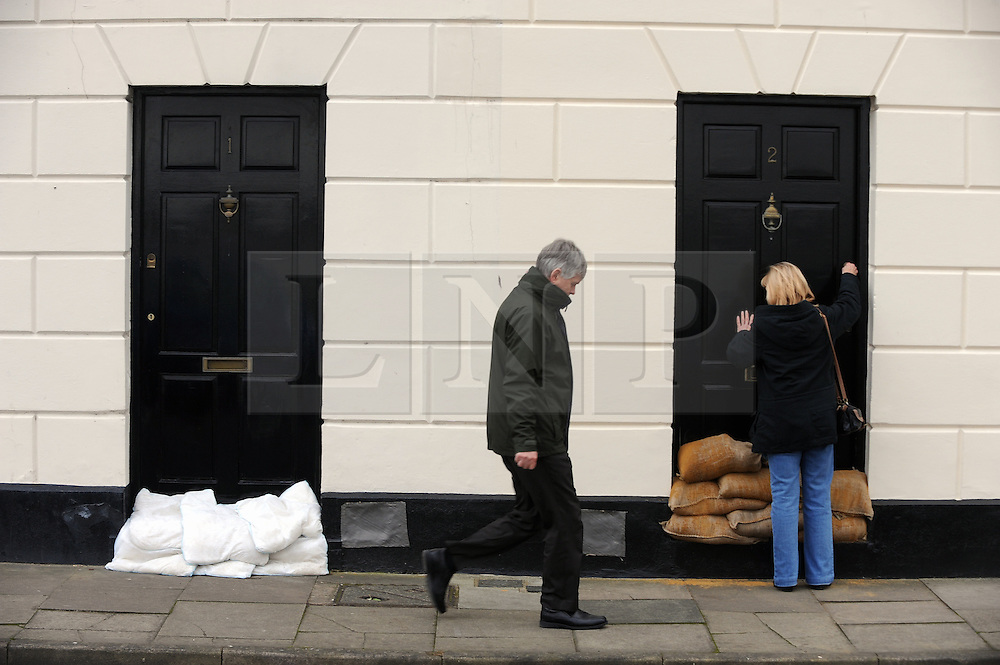 © Licensed to London News Pictures. 06/12/2013<br /> Homes in Royal Pier Mews,Gravesend protected with sand bags.<br /> Gravesend Riverside,Gravesend, Kent Tidal surge expected around 1pm which could put lives at risk in Greenhithe and Gravesend in Kent.<br /> The Met office has given a severe weather warning for parts of the UK  tidal surge in the Thames estuary is expected at 1pm today (06.12.2013)<br /> Photo credit :Grant Falvey/LNP