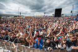 © Licensed to London News Pictures. 23/08/2014. Reading, UK.   Festival goers watch Pulled Apart By Horses performing live at Reading Festival 2014 on Saturday Day 2.     Photo credit : Richard Isaac/LNP