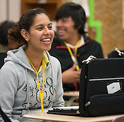 Students receive laptops during PowerUp distribution at Lee High School, February 4, 2014.