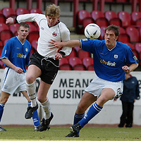 Clyde v St Johnstone...06.03.04<br />Andy Smith is challenged by Ian Maxwell<br /><br />Picture by Graeme Hart.<br />Copyright Perthshire Picture Agency<br />Tel: 01738 623350  Mobile: 07990 594431