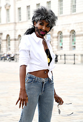 Sinitta, dressed as Simon Cowell, attending the X Factor photocall held at Somerset House, London.