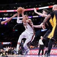 27 February 2015: Milwaukee Bucks forward Giannis Antetokounmpo (34) drives past Los Angeles Lakers forward Ryan Kelly (4) during the Los Angeles Lakers 101-93 victory over the Milwaukee Bucks, at the Staples Center, Los Angeles, California, USA.