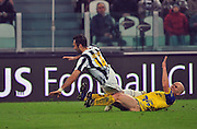 Michael Bradley shorts ride high as high tackles Vucinic of Juventus.