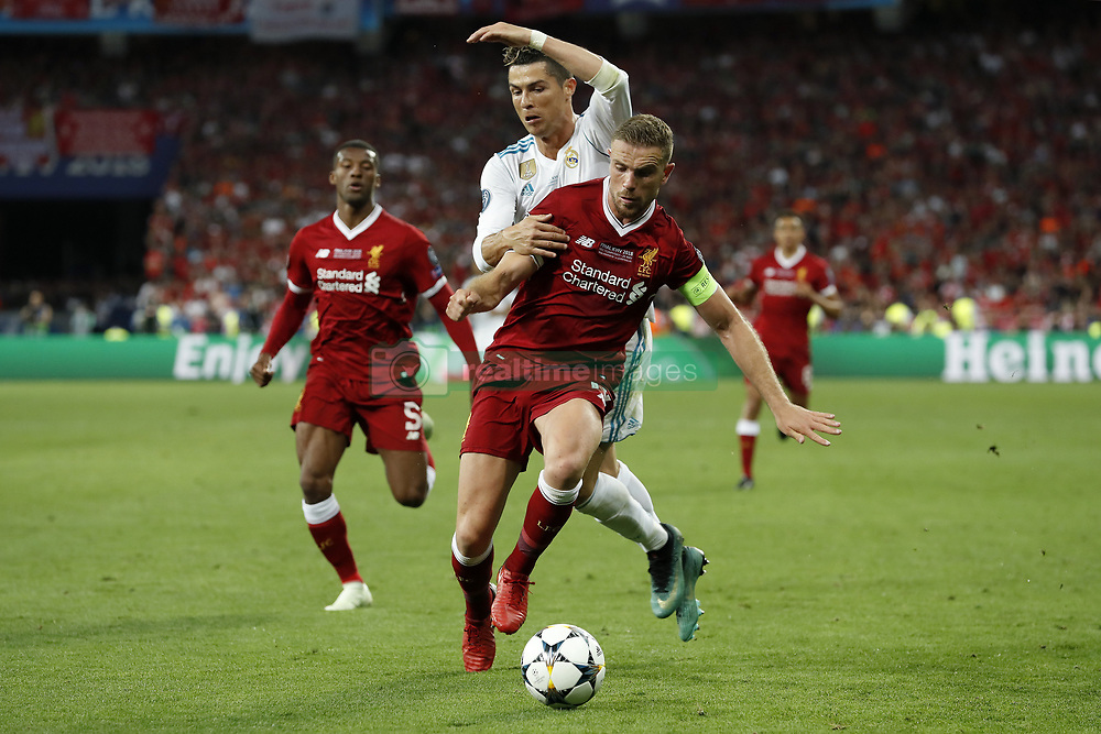 (L-R) Georginio Wijnaldum of Liverpool FC, Jordan Henderson of Liverpool FC, Cristiano Ronaldo of Real Madrid during the UEFA Champions League final between Real Madrid and Liverpool on May 26, 2018 at NSC Olimpiyskiy Stadium in Kyiv, Ukraine