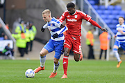 Cardiff City defender Bruno Ecuele Manga tracks back with Reading FC striker Matej Vydra during the Sky Bet Championship match between Reading and Cardiff City at the Madejski Stadium, Reading, England on 19 March 2016. Photo by Mark Davies.