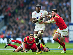 Maro Itoje of England takes on the Wales defence - Mandatory byline: Patrick Khachfe/JMP - 07966 386802 - 12/03/2016 - RUGBY UNION - Twickenham Stadium - London, England - England v Wales - RBS Six Nations.