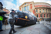 UNITED KINGDOM, London: 26 February 2018 <br /> A 23 foot Lancaster Bomber replica is wheeled into position in front of The Royal Albert Hall this morning to mark the 75th anniversary since 'Operation Chastise' was given final approval. It also comes before a gala screening of The Dam Busters which will be shown in May to make the occasion.<br /> Photograph: Rick Findler