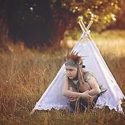 Girl in teepee