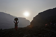 Villagers scavenge coal from an open-cast coal mine in Dhanbad, Jharkhand, India on Dec 6, 2014, trying to earn a few dollars a day. <br /> (Photo by Kuni Takahashi)