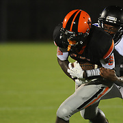 New Hanover High School's Karon Reid  is tackled by Wilson Hunt's Tae Davis Friday September 5, 2014 in Wilmington, N.C. (Jason A. Frizzelle)