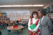 Dean Middleton,Dean of the College of Education visits .Chauncey Elementary. ..This month, Dean Middleton is starting a campaign to visit every K-12 public school in the 29 counties of Appalachian Ohio within the next 5 years...Names of People:..Mrs. Linda Rolli, Principal(red dress)