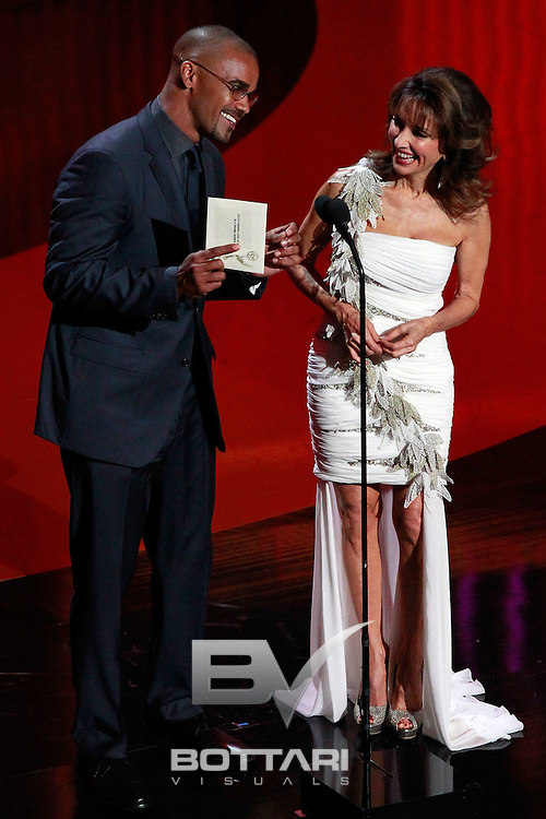 From left, actors Shemar Moore and Susan Lucci speak onstage during the Daytime Emmy Awards on Sunday June 19, 2011 in Las Vegas. (AP Photo/Jeff Bottari)