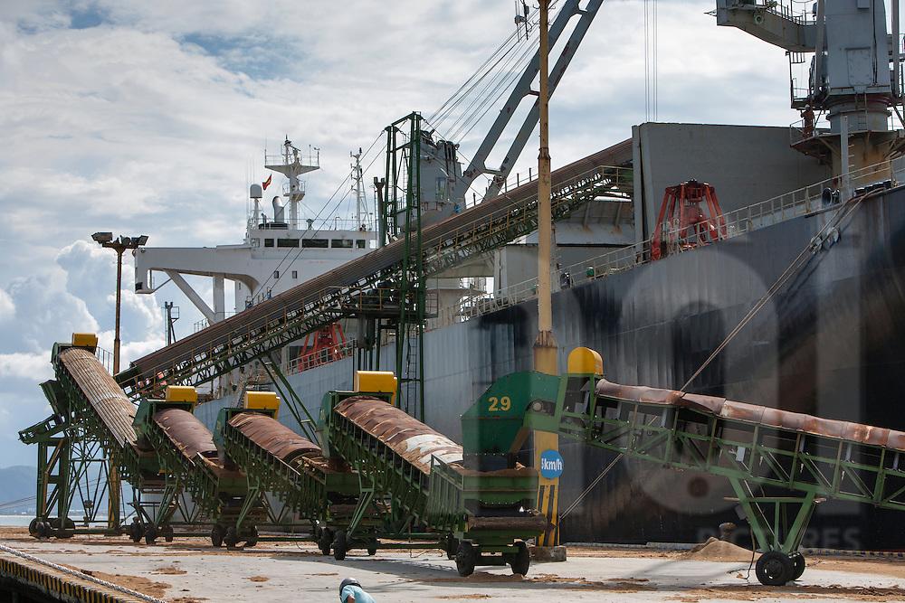 Conveyor belt loading goods on Stella Cupid vessel in Danang harbour, Vietnam, Asia