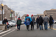 Trump supporters walk toward the National Mall  on the morning of the Presidential Inauguration.<br />