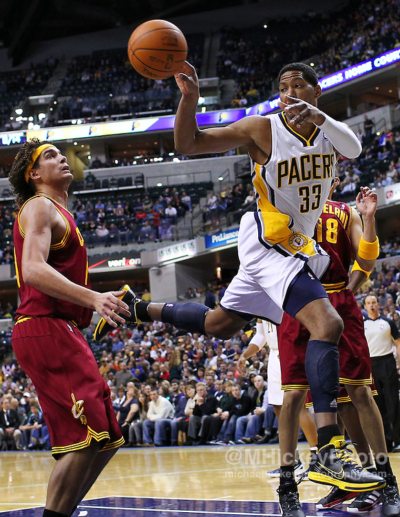Dec. 30, 2011; Indianapolis, IN, USA; Indiana Pacers small forward Danny Granger (33) passes the ball off against the Cleveland Cavaliers at Bankers Life Fieldshouse. Mandatory credit: Michael Hickey-US PRESSWIRE