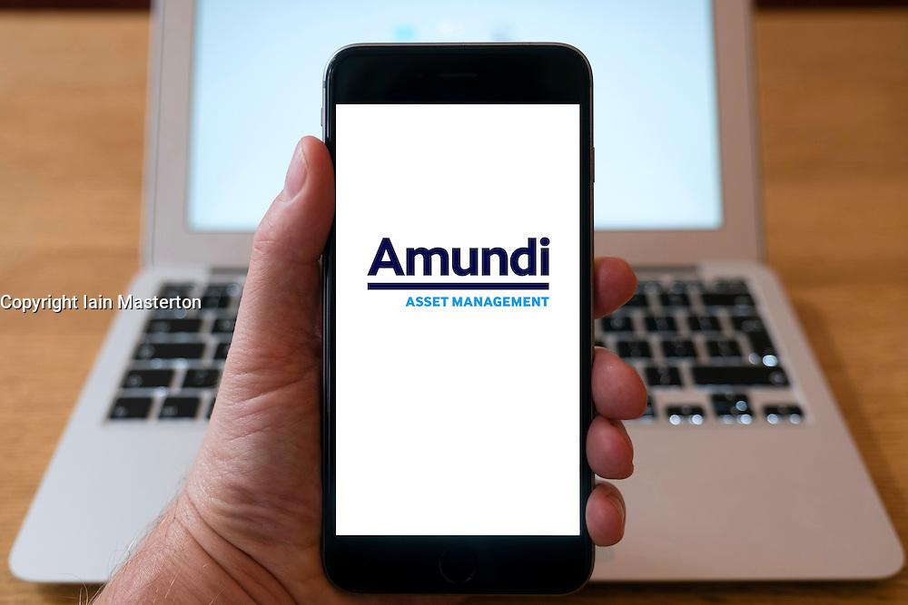Amundi fund management company logo on smart phone screen.