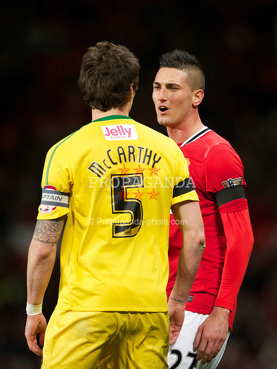 MANCHESTER, ENGLAND - Wednesday, November 29, 2011: Manchester United's Federico Macheda clashes with Crystal Palace's Patrick McCarthy during the Football League Cup Quarter-Final match at Old Trafford. (Pic by David Rawcliffe/Propaganda)