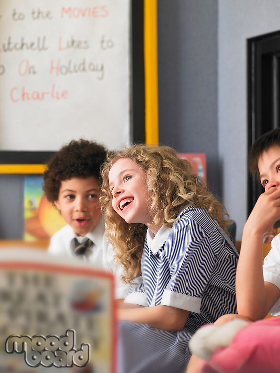 Elementary students laughing in classroom
