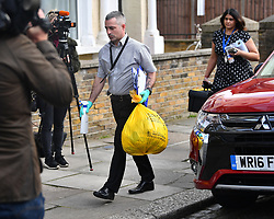 © Licensed to London News Pictures. 19/03/2017. London, UK. Items being carried from a property in  Wilberforce Road where one child has been found dead and another seriously injured in Finsbury Park, East London. Photo credit: Ben Cawthra/LNP