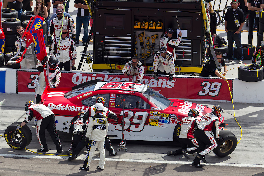 LAS VEGAS, NV - MAR 11, 2012:  Ryan Newman (39) brings his car in for service during the Kobalt Tools 400 race at the Las Vegas Motor Speedway in Las Vegas, NV.