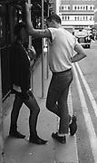 Gavin and Kelly stood by scaffolding, UK,  1980s.