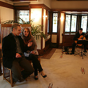 The National Park Service announced the Robie House, the 1910 masterpiece by architect Frank Lloyd Wright built in his classic Prairie Style, has been submitted to UNESCO for World Heritage nomination. Wright built the house for Frederick C. Robie on the campus of the University of Chicago in the neighborhood of Hyde Park in Chicago. David and Shelly Cowan enjoy live music by guitarist David Saenger (cq).<br /> Photography by Jose More