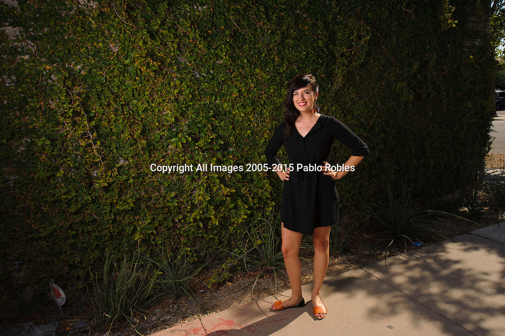 Casandra Hernandez poses for a portrait in Downtown Phoenix, AZ.