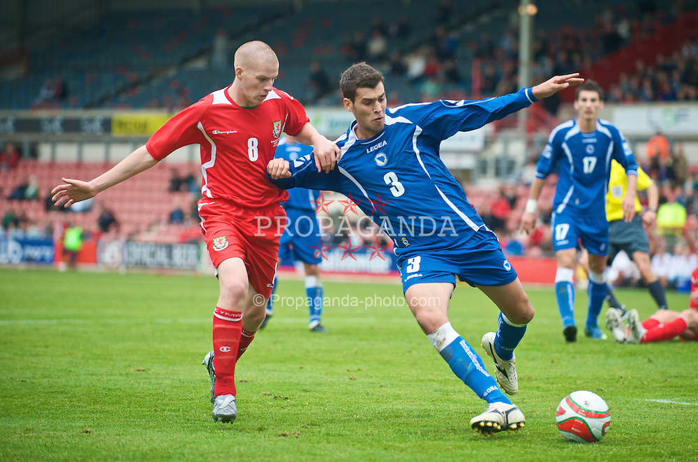 WREXHAM, WALES - Saturday, October 10, 2009: Wales' Nathan Craig and Bosnia-Herzegovina's Marin Anicic during the UEFA Under-21 Championship Qualifying Round Group 3 match at the Racecourse Ground. (Pic by Chris Brunskill/Propaganda)