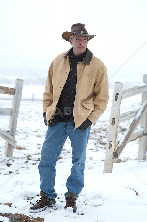rugged good looking cowboy on a ranch in Vermont during the Winter