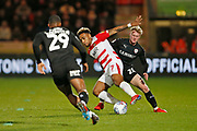 Mallik Wilks of Doncaster Rovers shields the ball from Barnsley forward Mamadou Thiam (26)  during the EFL Sky Bet League 1 match between Doncaster Rovers and Barnsley at the Keepmoat Stadium, Doncaster, England on 15 March 2019.
