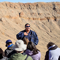 123113       Cable Hoover<br /> <br /> Tour guide Stephen Lang stops at a popular scenic overlook with his tour group Tuesday at Meteor Crater.