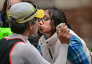 Sabrina D'Souza, a senior at Wellesley College, gives a smootch to a passing runner during the 119th running of the Boston Marathon along Central Street in Wellesley, April 20, 2015.   (Wicked Local Photo/James Jesson).