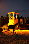 Groomers from the Barbados Turf Club bring the thoroughbred horses down to the ocean at dawn for cleaning and exercise.