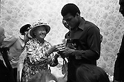 15/07/1972<br /> 07/15/1972<br /> 15 July 1972<br /> Muhammad Ali at Stewarts Hospital Fete, Palmerstown, Dublin. Ali is presented with a book on De Valera.