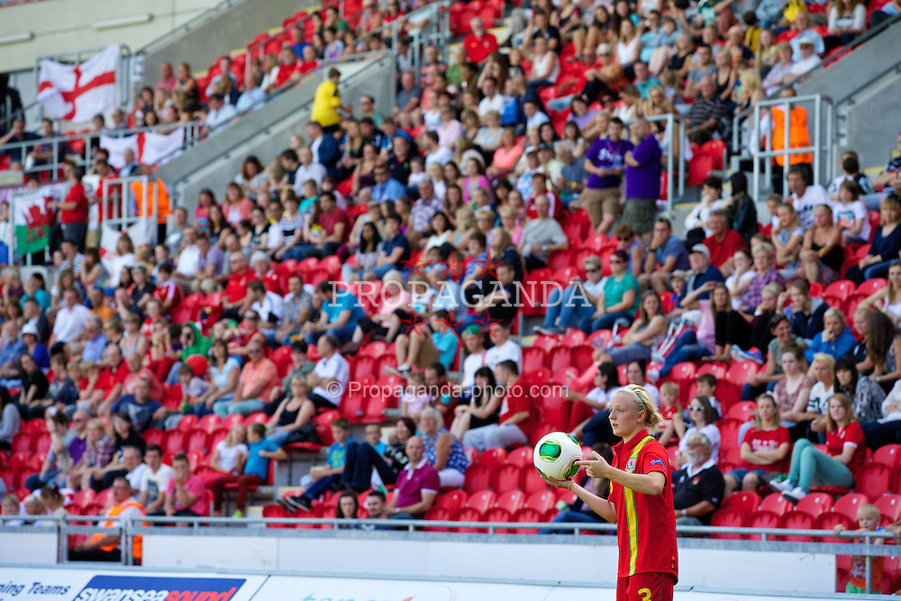 LLANELLI, WALES - Thursday, August 22, 2013: Wales' Lauren Hancock in action against England during the Group A match of the UEFA Women's Under-19 Championship Wales 2013 tournament at Parc y Scarlets. (Pic by David Rawcliffe/Propaganda)
