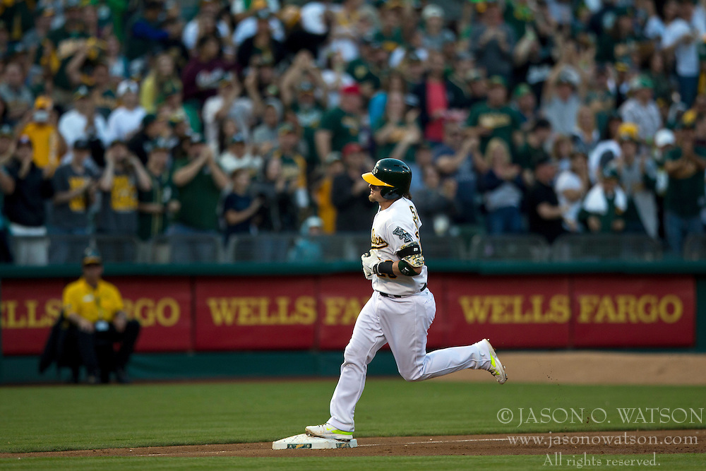 OAKLAND, CA - JULY 05:  Josh Donaldson #20 of the Oakland Athletics rounds the bases after hitting a home run against the Toronto Blue Jays during the third inning at O.co Coliseum on July 5, 2014 in Oakland, California. The Oakland Athletics defeated the Toronto Blue Jays 5-1.  (Photo by Jason O. Watson/Getty Images) *** Local Caption *** Josh Donaldson