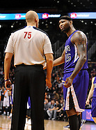 Dec. 17, 2012; Phoenix, AZ, USA; Sacramento Kings center DeMarcus Cousins (15) talks with NBA Official Eric Dalen (75) during the game against the Phoenix Suns in the second half at US Airways Center. The Suns defeated the Kings 101-90. Mandatory Credit: Jennifer Stewart-USA TODAY Sports