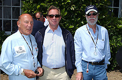 "Left to right, SIR STIRLING MOSS, PADDY MCNALLY and VISCOUNT COWDRAY at a luncheon hosted by Cartier at the 2005 Goodwood Festival of Speed on 26th June 2005.  Cartier sponsored the ""Style Et Luxe' for vintage cars on the final day of this annual event at Goodwood House, West Sussex. <br />