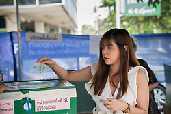 March 24, 2019 - Bangkok, Thailand - A young lady seen casting her ballot in a polling station..Thailand is hosting its first General Election in 8 years. Polling stations opens from 8am until 5pm. (Credit Image: © Geovien So/SOPA Images via ZUMA Wire)