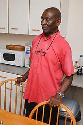 Elderly black man in kitchen
