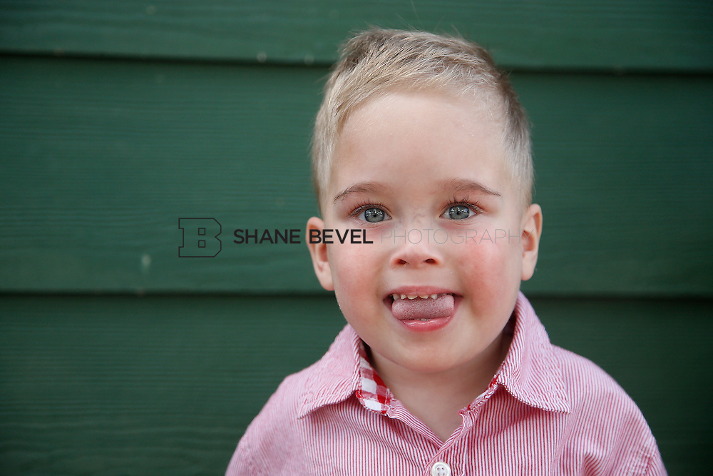 5/28/15 5:34:16 PM -- Miracle Miles and his family pose for portraits and play at the QuikTrip park for the 2015 Saint Francis Health System advertising campaign. <br /> <br /> Photo by Shane Bevel