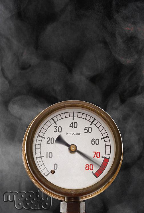Pressure gauge at maximum omitting smoke in studio