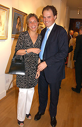EVY & EMILY HAMBRO at an exhibition of art by Sam Sopwith held at 27 Cork Street, London W1 on 23rd May 2006.<br />