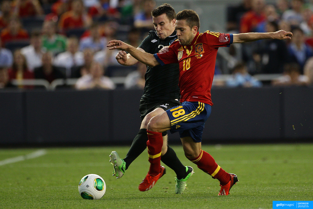 Jordi Alba, Spain, is challenged by Seamus Coleman, Ireland, during the Spain V Ireland International Friendly football match at Yankee Stadium, The Bronx, New York. USA. 11th June 2013. Photo Tim Clayton