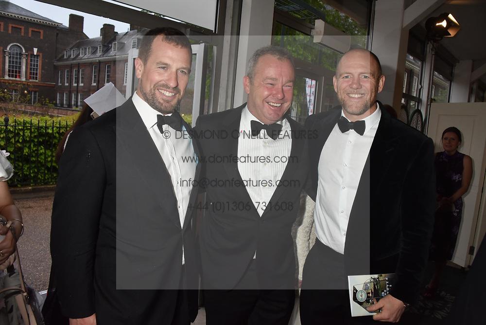 Peter Phillips, David Yarrow and Mike Tindall at the Tusk Ball at Kensington Palace, London, England. 09 May 2019.