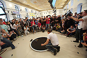 "Standard Sumo finals: victory for ""Master of Disaster"" from Lithuania. RobotChallenge 2010. First European Robot Sumo Championship..Two robots compete and try to push the competitor off the ring. There are different classes: Standard (3kg), Mini (500g), Micro (100g), Nano (25g) and Humanoid Sumo."