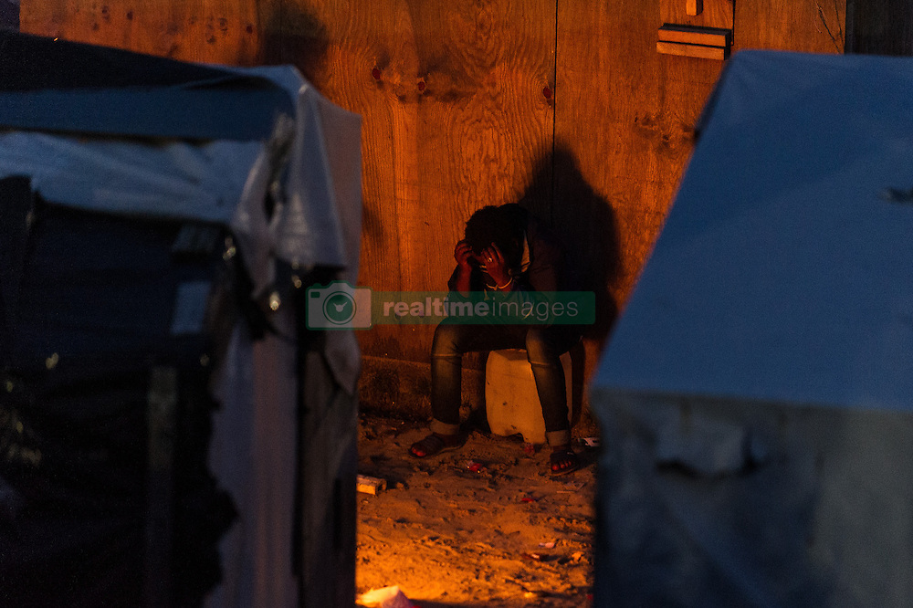 October 24, 2016 - Calais, France - A Migrant sitzt in the Calais Jungle between the huts at a campfire in Calais, France on 2016. The refugee camp on the coast to the English Channel is to be cleared today. The approximately 8,000 refugees are distributed after the registration by busses to various reception centers in France. (Credit Image: © Markus Heine/NurPhoto via ZUMA Press)