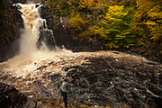 Fisherman casts for salmon, Kirkaig falls, near Suilven, autumn in the The Highlands, NW Scotland